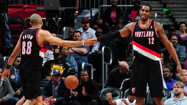 ATLANTA, GA - MARCH 27: LaMarcus Aldridge #12 and Nicolas Batum #88 of the Portland Trail Blazers greet eachother against the Atlanta Hawks on March 27, 2014 at Philips Arena in Atlanta, Georgia.  NOTE TO USER: User expressly acknowledges and agrees that, by downloading and/or using this Photograph, user is consenting to the terms and conditions of the Getty Images License Agreement. Mandatory Copyright Notice: Copyright 2014 NBAE (Photo by Scott Cunningham/NBAE via Getty Images)