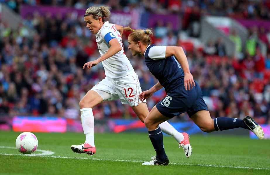 MANCHESTER, ENGLAND - AUGUST 06:  Christine Sinclair of Canada is challenged by Rachel Buehler (R) of USA during the Women's Football Semi Final match between Canada and USA on Day 10 of the London 2012 Olympic Games at Old Trafford on August 6, 2012 in Manchester, England.  (Photo by Stanley Chou/Getty Images)