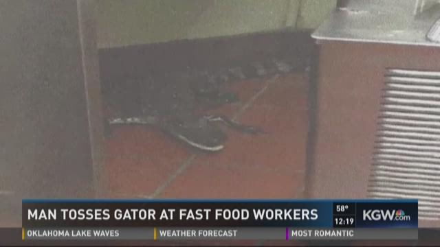 Man tosses gators at fast food workers