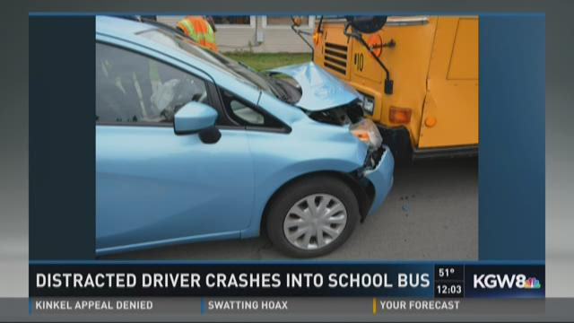 Distraced driver crashes into school bus
