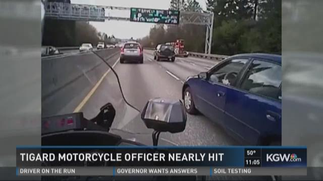 Tigard motorcycle officer nearly hit