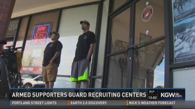 Armed supporters guard recruiting centers