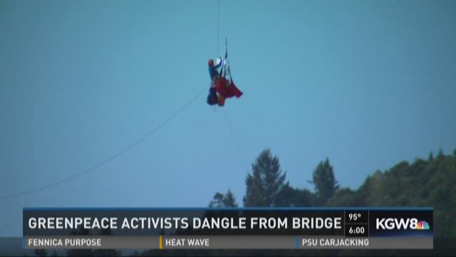Greenpeace activists dangle from the St. Johns Bridge.
