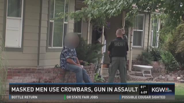 Masked men use crowbars, gun in assault